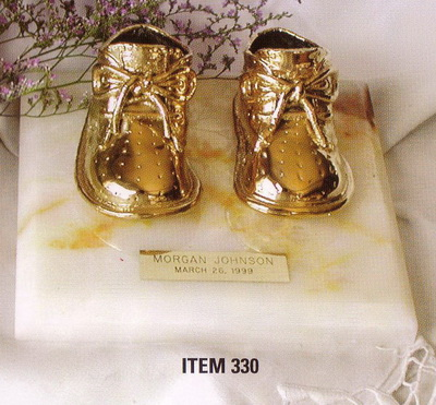 Judy Haberl Bronze Baby Shoe sculpture Archives | Lucia Pottery